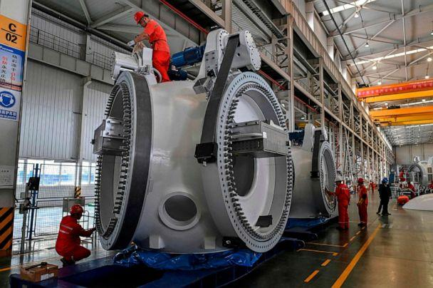 PHOTO: Workers at a plant during the production process of wind turbines during a government organized tour at Goldwind Technology in Yancheng, in Jiangsu province, Oct. 14, 2020. (Hector Retamal/AFP via Getty Images)