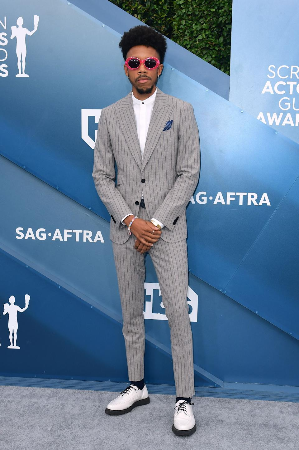 """<h2>Darrell Britt-Gibson</h2><br>Darrel Britt-Gibson's SAG Awards look is right on <em>The Wire</em>. <span class=""""copyright"""">Photo by FREDERIC J. BROWN/AFP via Getty Images.</span>"""
