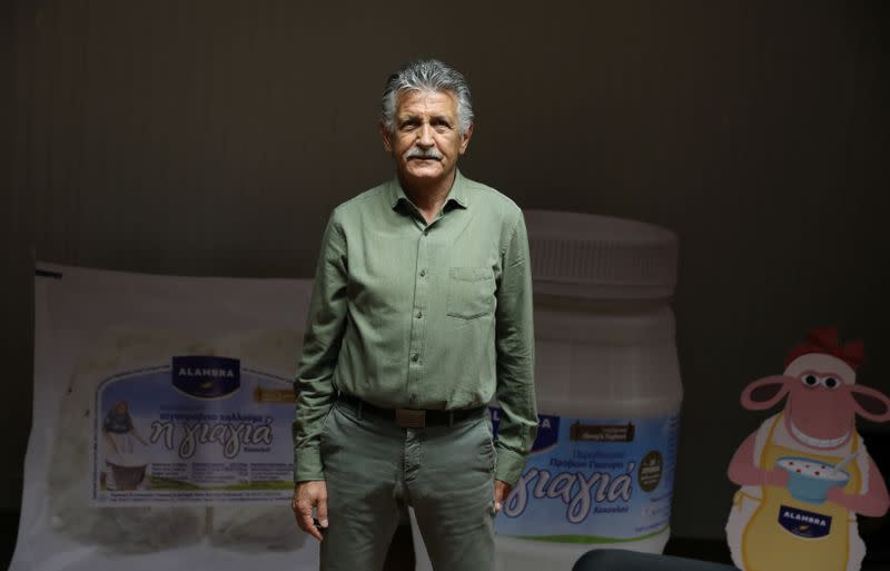 GM George Petrou of Petrou Bros Dairy Products poses for a photo in the factory in Aradippou