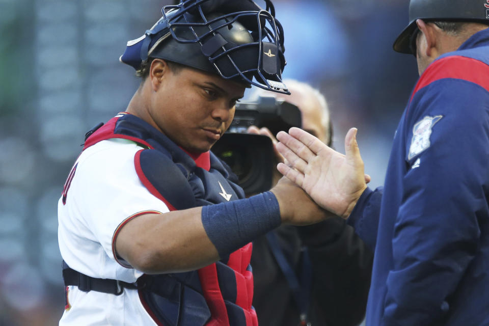 Minnesota Twins' Willians Astudillo, left, goes through the celebration line after the team defeated the Chicago White Sox in the first game of a baseball doubleheader Friday, Sept. 28, 2018, in Minneapolis. (AP Photo/Jim Mone)