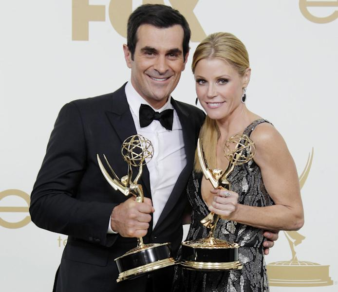 "FILE - This Sept. 18, 2011 file photo shows Ty Burrell, left, Julie Bowen from the television series ""Modern Family"" holding their Emmys for best supporting and actress actress in a comedy, backstage at the 63rd Primetime Emmy Awards in Los Angeles. Five stars of the hit ABC series sued 20th Century Fox Television on Tuesday July 24, 2012, claiming their contracts with the studio are illegal under California law and should be invalidated. (AP Photo/Jae Hong, file)"