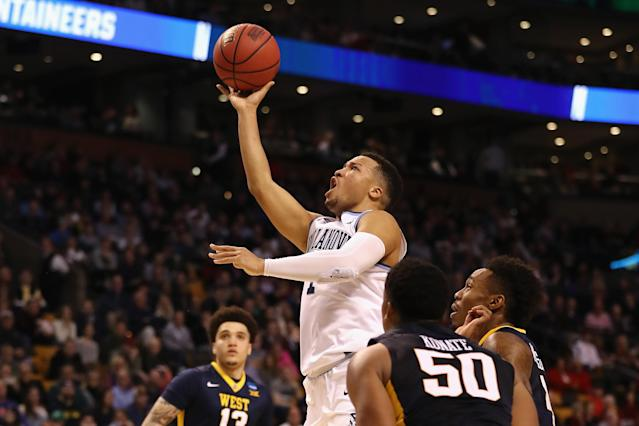 Jalen Brunson drives against West Virginia in Villanova's Sweet 16 game on Friday night. (Getty)