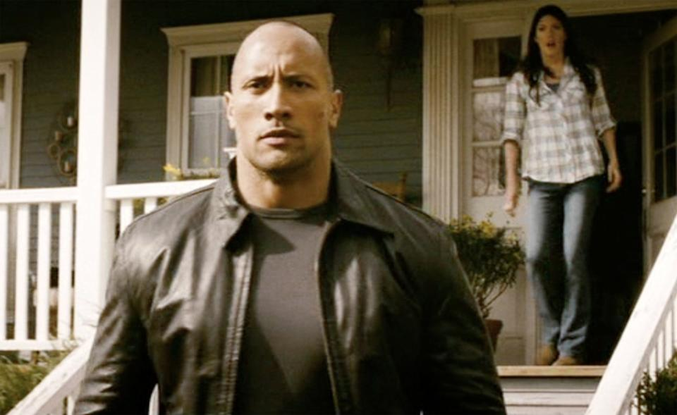 PASADENA - NOVEMBER 24: FASTER, theatrical movie originally released November 24, 2010.  Film directed by George Tillman, Jr. Pictured left to right, Dwayne Johnson (as Driver / James Cullen), and Jennifer Carpenter (as Woman / Nan Porterman, in background). Frame grab. (Photo by CBS Films/Sony Pictures/CBS via Getty Images)
