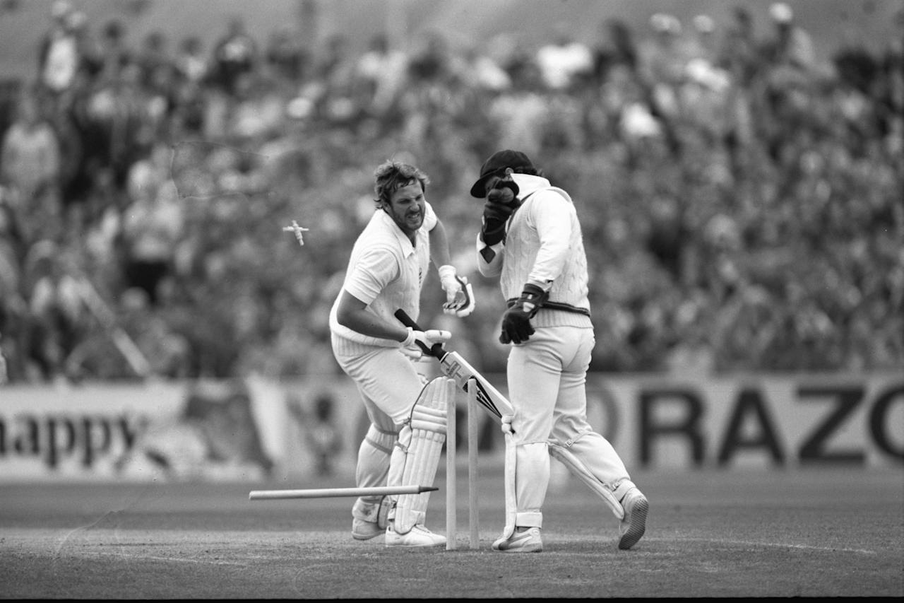 Aug 1981:  Rodney Marsh of Australia attempts to stump Ian Botham of England during Botham's century in the 5th Test at Manchester.  Mandatory Credit:  Adrian Murrell/Allsport UK