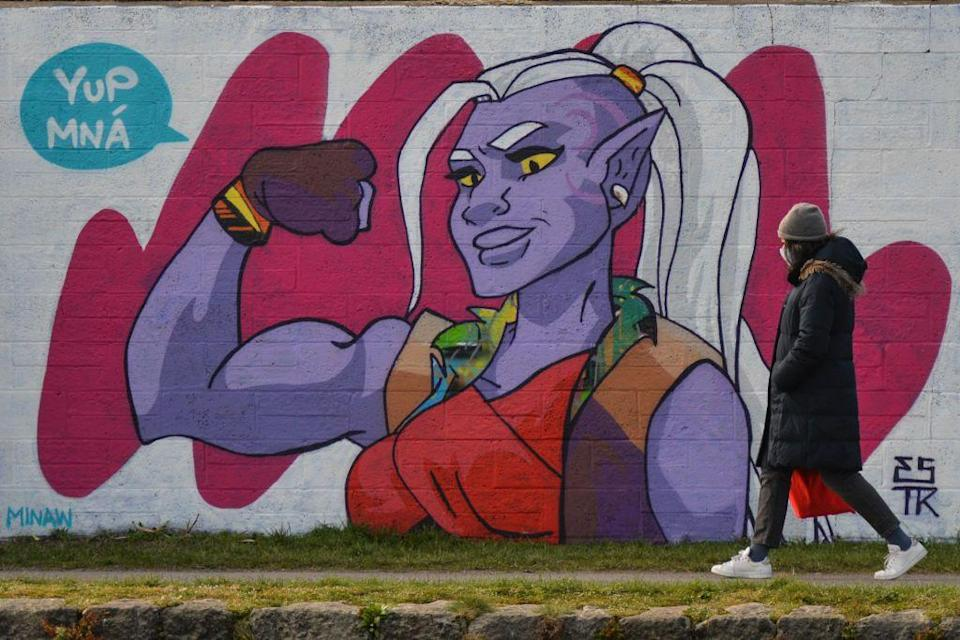 A woman walks by the mural of Huntara from Netflix's 'She-Ra and the Princesses of Power' in Dublin's Grand Canal area painted by Irish artist Emmalene Blake for International Women's Day.  On Monday, 8 March, 2021, in Dublin, Ireland. (Photo by Artur Widak/NurPhoto via Getty Images) (Photo: NurPhoto via NurPhoto via Getty Images)