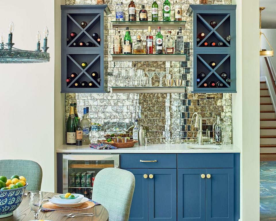 "<p>Hostesses, this one's for you. If you don't have a butler's pantry off the kitchen, using a nearby wall to either display your beautiful glassware and favorite bottles of wine—or go all out with a small wet bar—can save you an entertaining headache. </p><p>""Incorporate a dedicated area for a bar and beverages outside of the main working space in the kitchen,"" Serany says. ""It allows family and guests the ability to socialize without interrupting the cook!""</p>"