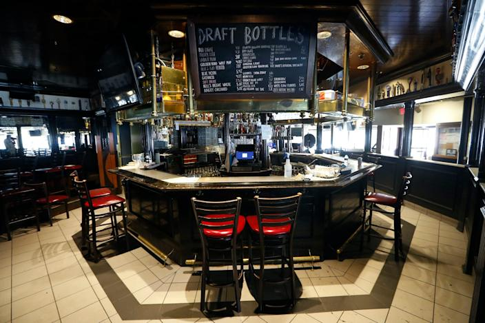 """This June 8, 2020 photo shows the bar area at Good Time Charley's in Ann Arbor, Mich. When the pandemic sent many of the school's 40,000-plus students back to all parts of the globe earlier in the year, the center of the college town's small-business district became eerily quiet. <p class=""""copyright""""><a href=""""https://newsroom.ap.org/detail/VirusOutbreakSmallBusinessStrugglesAnnArbor/bc69afb893ef4ae08016b802b55ea24f/photo?Query=university%20AND%20bar&mediaType=photo,video&sortBy=arrivaldatetime:desc&dateRange=Anytime&totalCount=494&currentItemNo=0"""" rel=""""nofollow noopener"""" target=""""_blank"""" data-ylk=""""slk:AP Photo/Paul Sancya"""" class=""""link rapid-noclick-resp"""">AP Photo/Paul Sancya</a></p>"""