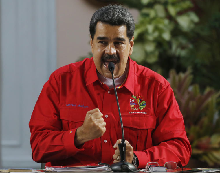 Venezuela's President Nicolas Maduro speaks during the closing ceremony of the Sao Paulo Forum at Miraflores presidential palace in Caracas, Venezuela, Sunday, July 28, 2019. The Sao Paulo forum, held almost annually and hosted by Cuba last year, was founded as Latin American leftists sought to re-organize after the fall of the Berlin Wall in 1989. (AP Photo/Ariana Cubillos)