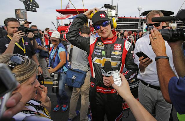 Kurt Busch prepares for interviews before the NASCAR Sprint Cup series Coca-Cola 600 auto race at Charlotte Motor Speedway in Concord, N.C., Sunday, May 25, 2014. (AP Photo/Terry Renna)