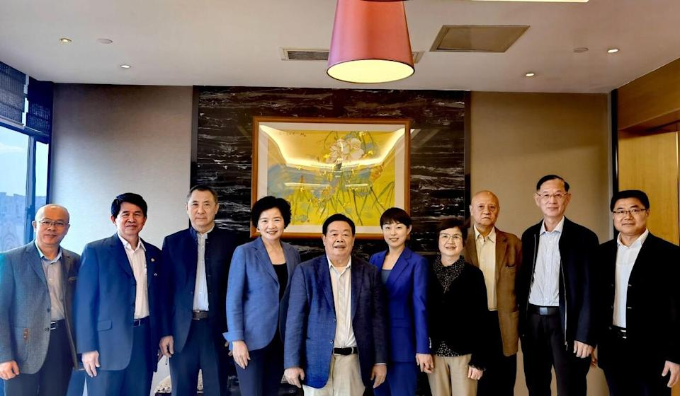 Cao Dewang, the founder of China's largest car glassmaker Fuyao Glass Industry Group (fifth to left), plans to establish a technology university in his hometown of Fuzhou, China. Photo: Handout