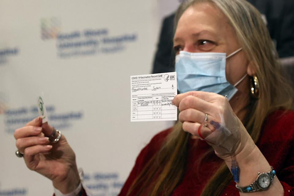 BAY SHORE, NEW YORK - MARCH 03: Susan Maxwell-Trumble holds up a vaccination card at South Shore University Hospital after receiving the Johnson & Johnson COVID-19 vaccine on March 03, 2021 in Bay Shore, New York. The new vaccine from the American pharmaceutical company is a single shot vaccine that has shown 85 percent protection against severe disease and can be stored at regular refrigeration temperatures. (Photo by Spencer Platt/Getty Images)