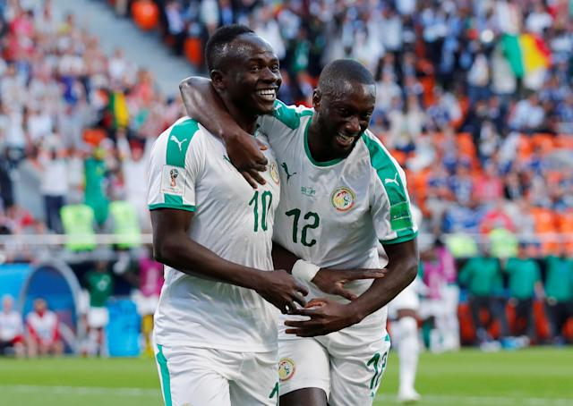 Soccer Football - World Cup - Group H - Japan vs Senegal - Ekaterinburg Arena, Yekaterinburg, Russia - June 24, 2018 Senegal's Sadio Mane celebrates with Youssouf Sabaly after scoring their first goal REUTERS/Andrew Couldridge