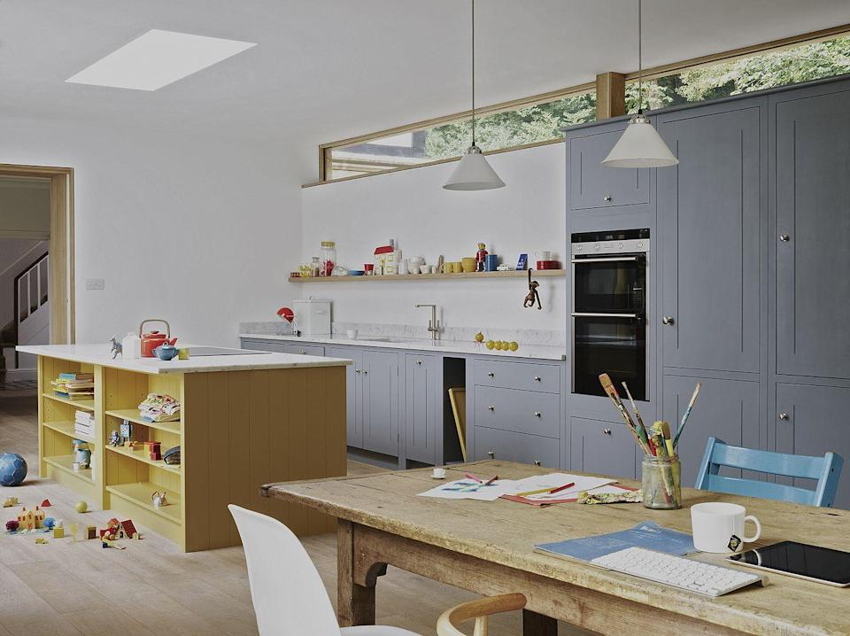 "<p>The rise of the 'working kitchen' reflects a repurposing of the traditional kitchen and an increased demand for multi-functional spaces. </p><p>There's a focus on integrated seating areas, low-level and full height storage solutions, and extended <a href=""https://www.housebeautiful.com/uk/decorate/kitchen/a28841957/breakfast-bar-ideas/"" rel=""nofollow noopener"" target=""_blank"" data-ylk=""slk:breakfast bars"" class=""link rapid-noclick-resp"">breakfast bars</a> or island units that become an all-inclusive workstation, complete with food prep areas and space for cooking, dining and <a href=""https://www.housebeautiful.com/uk/lifestyle/a28785307/work-from-home/"" rel=""nofollow noopener"" target=""_blank"" data-ylk=""slk:home office work"" class=""link rapid-noclick-resp"">home office work</a>.<br></p><p>Worktables and islands offer added space and clever storage to hide not only kitchen items but also office paraphernalia.<br></p><p>'Many homeowners are adding more storage solutions into their kitchens as a way of storing their office supplies as they adapt to working from home indefinitely,' adds Paul Jenkinson, Founder and Managing Director of <a href=""https://www.lochannakitchens.co.uk/"" rel=""nofollow noopener"" target=""_blank"" data-ylk=""slk:LochAnna Kitchens"" class=""link rapid-noclick-resp"">LochAnna Kitchens</a>.<br></p><p>Pictured: <a href=""https://britishstandardcupboards.co.uk/"" rel=""nofollow noopener"" target=""_blank"" data-ylk=""slk:British Standard by Plain English"" class=""link rapid-noclick-resp"">British Standard by Plain English</a></p>"