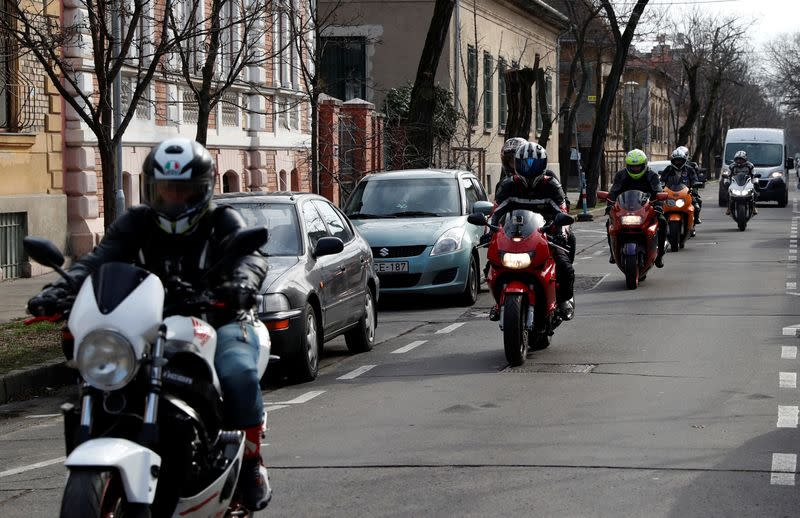 Members of the 'Easy Riders', a Hungarian bikers group, arrive to help a domestic violence victim in Budapest