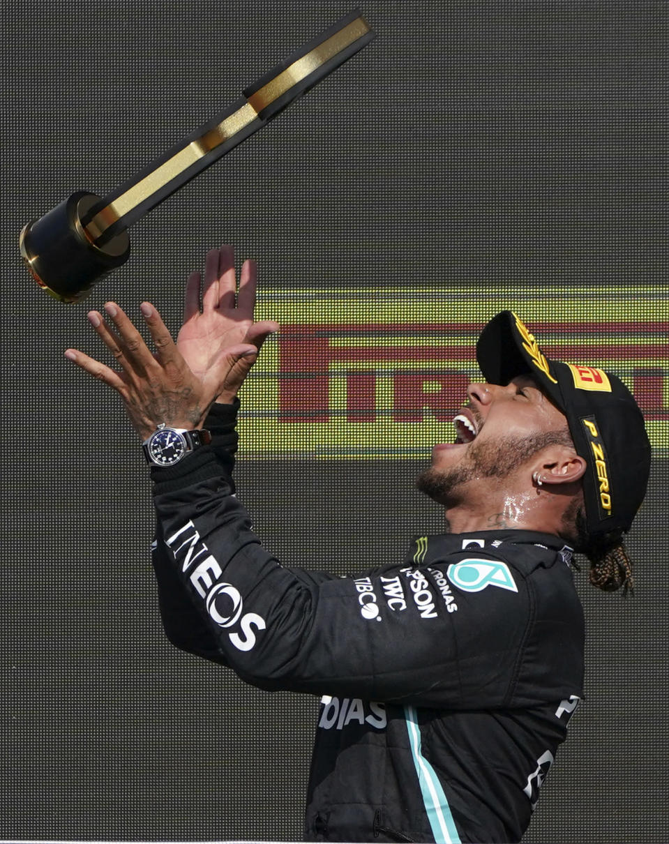 Mercedes driver Lewis Hamilton of Britain celebrates on the podium after winning the British Formula One Grand Prix, at the Silverstone circuit, in Silverstone, England, Sunday, July 18, 2021. (AP Photo/Jon Super)