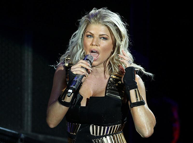 FILE - This Sept. 30, 2011 file photo shows singer Fergie of the group Black Eyed Peas performing in in New York. Fergie has officially changed her name: The singer born Stacy Ann Ferguson is now Fergie Duhamel. The Grammy winner's representative confirmed the name change Friday, Aug. 16, 2013. (AP Photo/ Donald Traill, File)