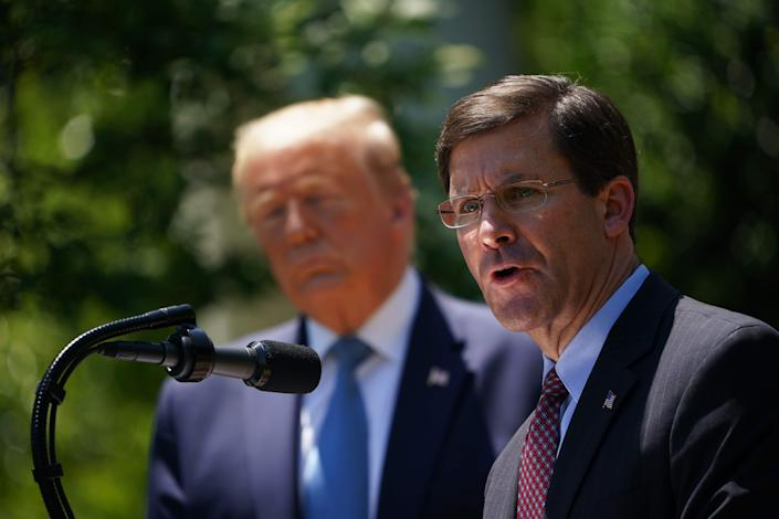 Defense Secretary Mark Esper, with President Donald Trump, speaks on vaccine development on May 15, 2020, in the Rose Garden of the White House.