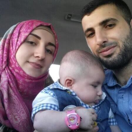 Aya Fadl with her husband Alaa and infant son Najdat  - Credit: Aya Fadl