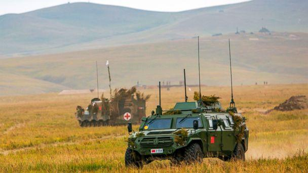 PHOTO: Chinese military vehicles through a field in Chita, Eastern Siberia, during the Vostok 2018 exercises, Sept. 11, 2018. (Russian Defense Ministry Press Service/AP)