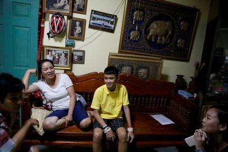 Duangpet Promtep and his aunt, whom he calls mother, Thanaporn Promthep smile during an interview at their home, in Mae Sai, the northern province of Chiang Rai, Thailand, July 19, 2018. REUTERS/Soe Zeya Tun