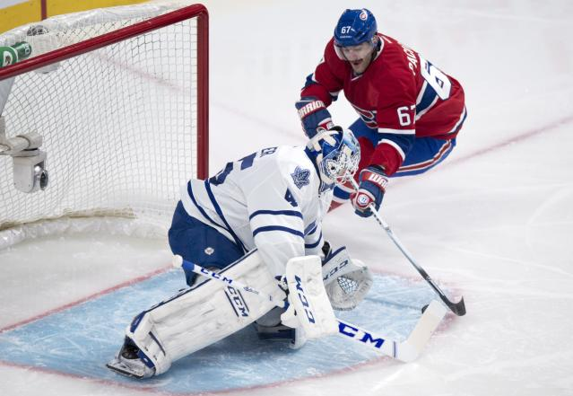 Montreal Canadiens' Max Pacioretty scores past Toronto Maple Leafs goalie Jonathan Bernier during the first period of an NHL hockey game Saturday, Nov. 30, 2013 in Montreal. (AP Photo/The Canadian Press, Paul Chiasson)