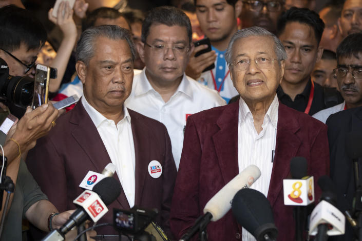 In this May 9, 2018, photo, Mahathir Mohamad, right, speaks to media during a press conference to announce victory on election as Muhyiddin Yassin, president of Malaysian United Indigenous Party stands next to him at a hotel in Kuala Lumpur, Malaysia. Bersatu party said in a statement Friday, Feb. 28, 2020 that 36 lawmakers, including nearly a dozen who defected from Anwar Ibrahim's party, have decided to support party President Muhyiddin Yassin instead of Mahathir as prime minister. (AP Photo/Vincent Thian)