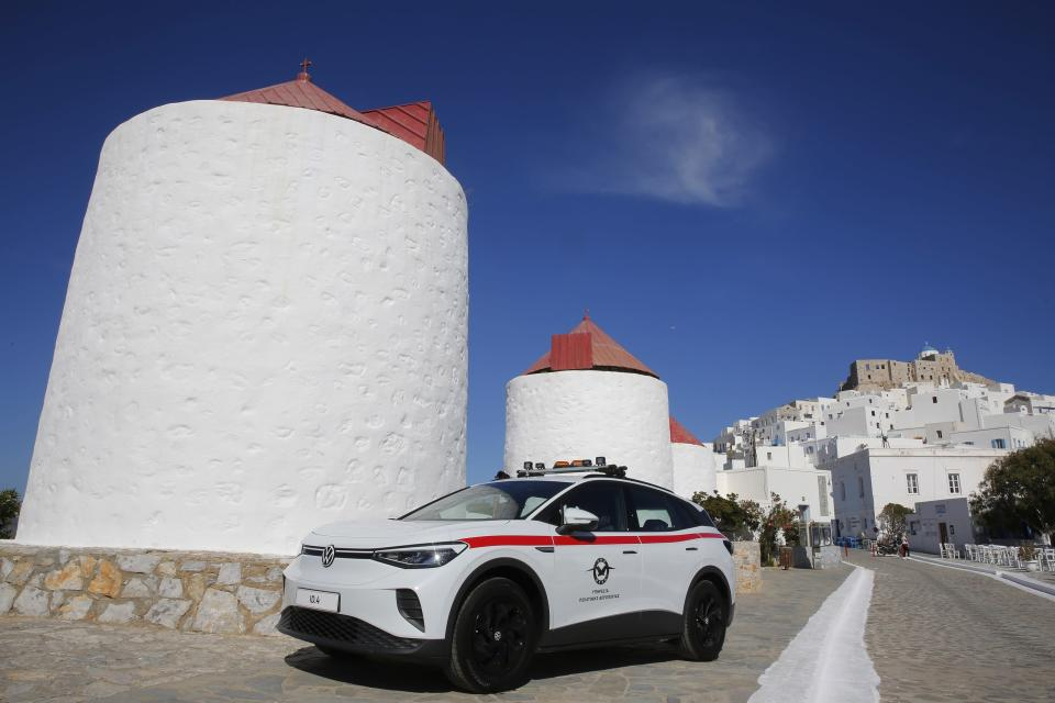 A Volkswagen ID.4 electric car of the Civil Aviation is parked on the Aegean Sea island of Astypalea, Greece during the official launch of a project to introduce and test electric vehicles and sustainable energy systems on Wednesday, June 2, 2021. The government has partnered with the German carmaker on the island project aimed a switching to electric vehicle use over the next five years. (Alexandros Vlachos/Pool via AP)