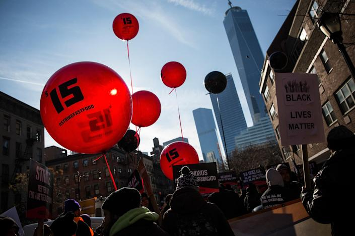 Protesters march through the streets demanding a raise on December 4, 2014 in New York (AFP Photo/Andrew Burton)