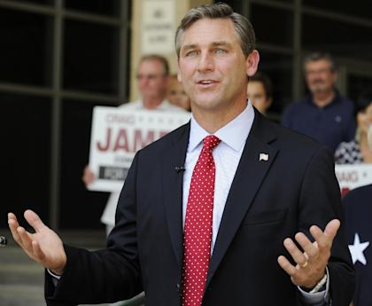 """FILE - In this May 24, 2012 file photo, Texas Republican candidate for the U.S. Senate Craig James gestures during a press conference in Houston. James says Fox Sports hit him with a """"sucker punch"""" _ inviting him to join a regional college football show, then firing him and telling the media he was too polarizing for TV. The longtime broadcaster and SMU star has accused Fox of discriminating against him due to his views opposing gay marriage, which he stated during a failed campaign two years ago for U.S. Senate. (AP Photo/Pat Sullivan, File)"""