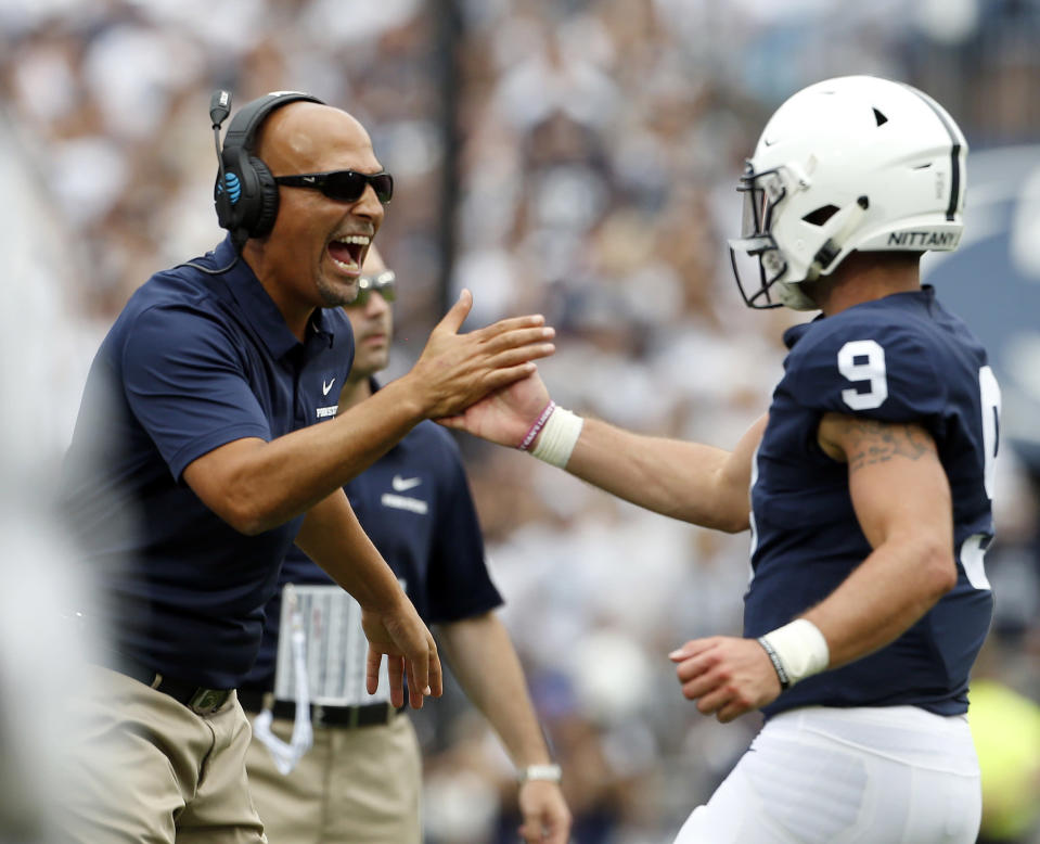 Penn State head coach James Franklin, left, congratulates quarterback Trace McSorley (9) after scoring against Appalachian State during the first half in State College, Pa., on Sept. 1, 2018. (AP Photo/Chris Knight)
