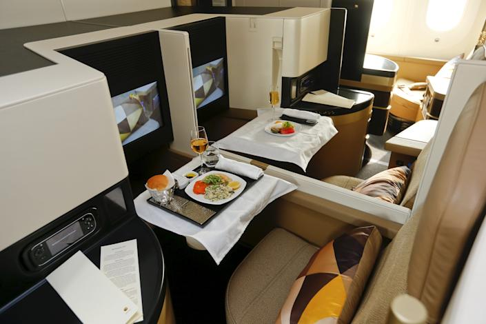 The new first class seats aboard an Etihad Airways Boeing 787 Dreamliner passenger jet are pictured during a media presentation at Zurich airport near the town of Kloten July 6, 2015. REUTERS/Arnd Wiegmann