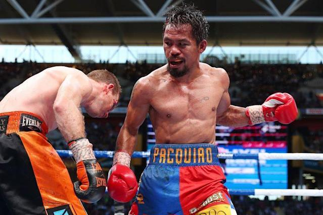 Manny Pacquiao punches Jeff Horn during their July 1 fight for the WBO welterweight title in Brisbane, Australia. (Getty)