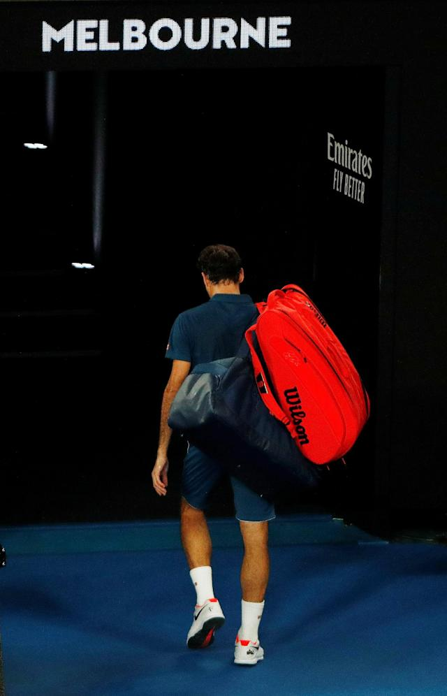Tennis - Australian Open - Fourth Round - Melbourne Park, Melbourne, Australia, January 20, 2019. Switzerland's Roger Federer leaves the court after losing the match against Greece's Stefanos Tsitsipas. REUTERS/Edgar Su TPX IMAGES OF THE DAY