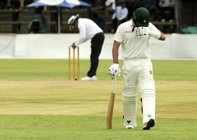 Zimbabwe batsman Sikandar Raza walks off the pitch after been dismissed during test cricket match against Sri Lanka at Harare Sports Club, Monday, Jan,20, 2020.Zimbabwe is playing in its first international match since the International Cricket Council lifted the country's ban last year(AP Photo/Tsvangirayi Mukwazhi)