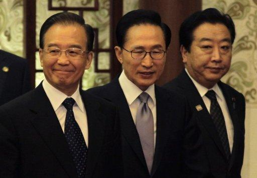 The leaders of China, Japan and South Korea have agreed to start talks this year on a free-trade area