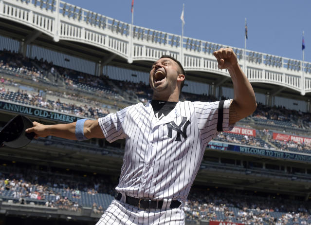 New York Yankees' Nick Swisher reacts when he is introduced at the Yankees Old Timer's Day baseball game Sunday, June 17, 2018, at Yankee Stadium in New York. (AP Photo/Bill Kostroun)