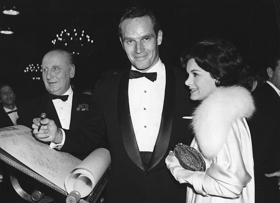 <p>Charlton Heston signs a scroll at the London premiere of <em>Ben-Hur </em>in December of 1959. The MGM epic was budgeted at approximately $15 million (roughly $145 million today). It grossed over $147 million (over $1.3 billion today), making it the second highest-grossing picture of its time, behind <em>Gone With the Wind.</em> </p>