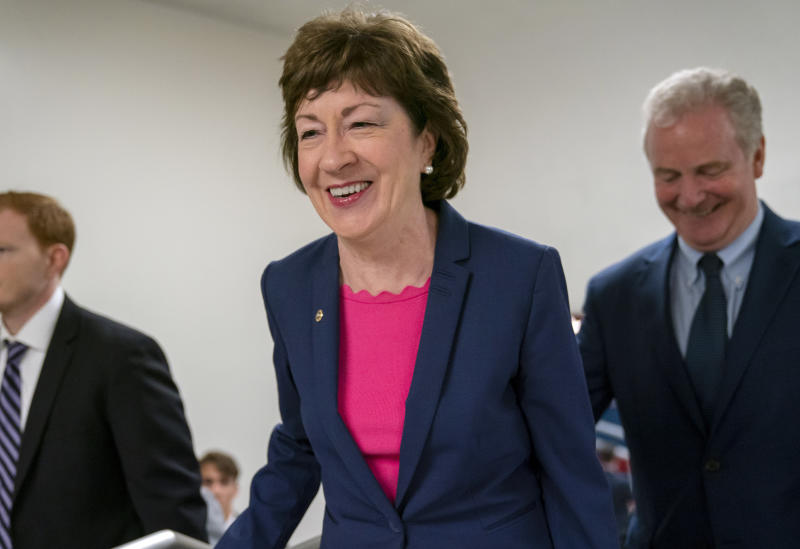 FILE - In this June 18, 2019 file photo, Sen. Susan Collins, R-Maine, center, arrives at the Capitol in Washington to extend her perfect Senate voting record to 7,000. National money is already flowing into Maine's 2020 Senate race, offering the latest indicator that incumbent Collins faces a stiff reelection fight.  Maine House Speaker Sara Gideon, D-Freeport, is challenging Collins in the 2020 election. (AP Photo/J. Scott Applewhite, File)