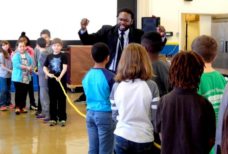 "Charles Woods leads a class in an interactive ""tug-of-war"" game around the civil rights movement"