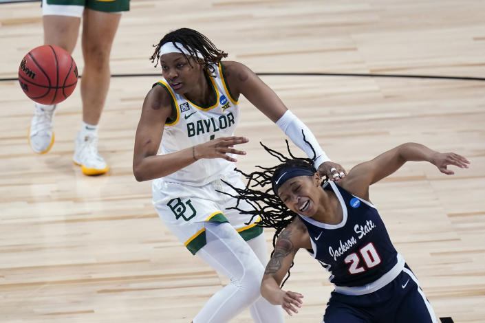 Baylor forward NaLyssa Smith, left, fights for a loose ball with Jackson State guard J'Niya Tallie (20) during the second half of a college basketball game in the first round of the women's NCAA tournament at the Alamodome, Sunday, March 21, 2021, in San Antonio. (AP Photo/Eric Gay)