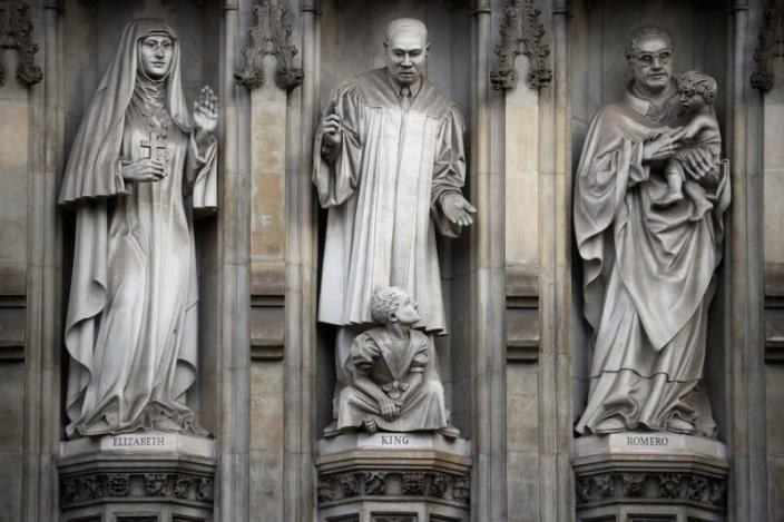 Stone carvings of figures are seen on the outside of Westminster Abbey in London