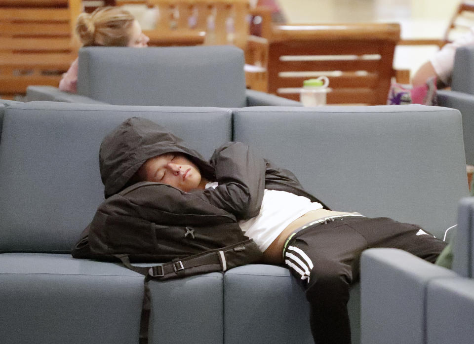 A traveler catches up on some sleep while waiting for a flight at Orlando International Airport, Wednesday, Nov. 21, 2018, before the start of the Thanksgiving holiday. (Photo: AP Photo/John Raoux)
