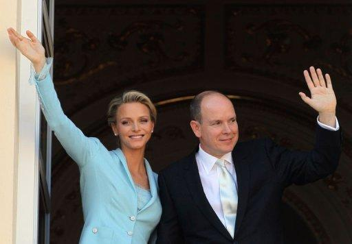 Prince Albert II and Princess Charlene of Monaco greet well-wishers from the balcony after their civil wedding