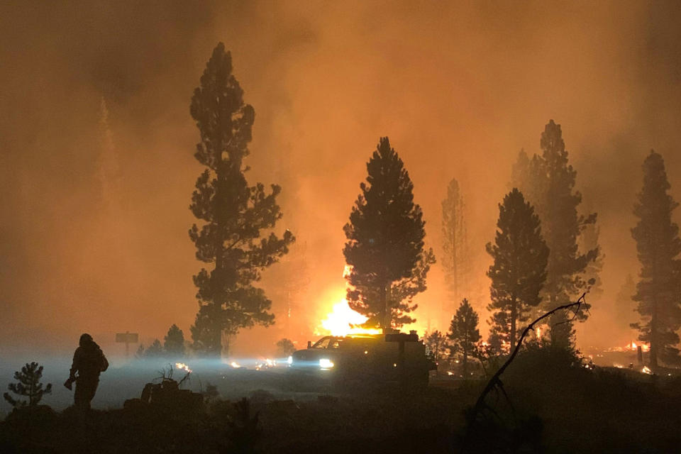 In this photo provided by the Bootleg Fire Incident Command, the Bootleg Fire burns at night in southern Oregon on July 17, 2021. / Credit: AP