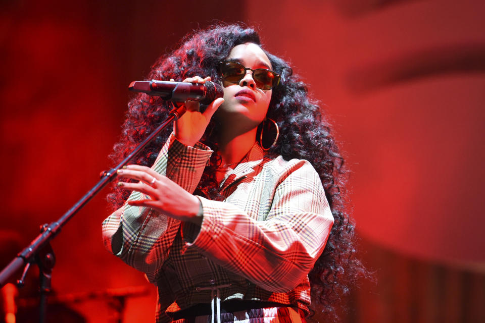"FILE - H.E.R. performs at the Spotify Best New Artist 2019 Party in Los Angeles on Feb. 7, 2019. R&B star Jazmine Sullivan and country singer Eric Church will join forces to sing the national anthem at the next month's Super Bowl, and Grammy-winning singer H.E.R. will perform ""America the Beautiful."" (Photo by Phil McCarten/Invision/AP, File)"