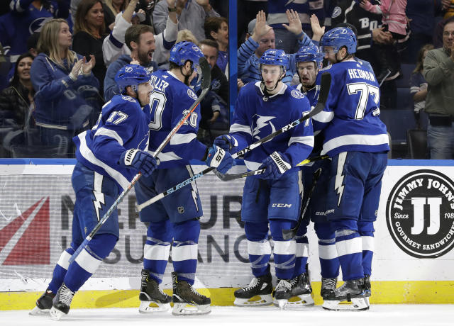 Tampa Bay Lightning left wing Alex Killorn (17) celebrates his goal against the Toronto Maple Leafs with teammates, including center J.T. Miller (10), center Anthony Cirelli (71) and defenseman Victor Hedman (77) during the second period of an NHL hockey game Thursday, Dec. 13, 2018, in Tampa, Fla. (AP Photo/Chris O'Meara)