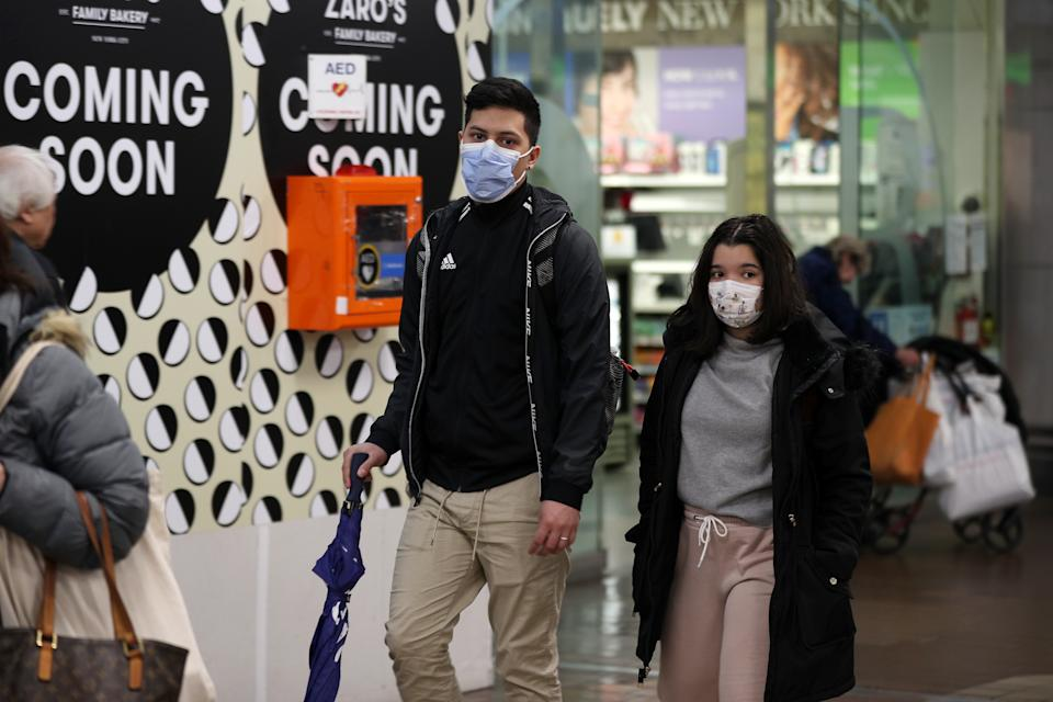 People wear face masks as a precaution against coronavirus in New York, United States.