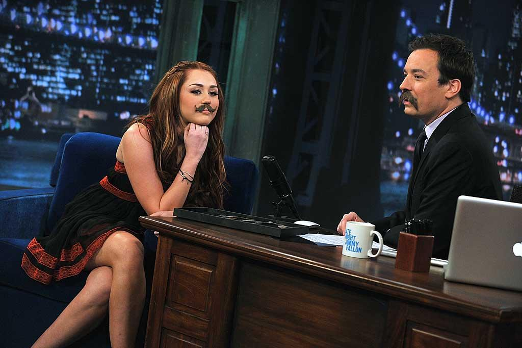 """Fellow singer Miley Cyrus revealed a few secrets of her own Thursday night on """"Late Night With Jimmy Fallon."""" The teen queen chatted about her upcoming hosting gig on """"Saturday Night Live"""" this weekend, missing """"Hannah Montana,"""" being spoofed on """"SNL,"""" and her odd obsession with ... mustaches. Theo Wargo/<a href=""""http://www.gettyimages.com/"""" target=""""new"""">GettyImages.com</a> - March 3, 2011"""