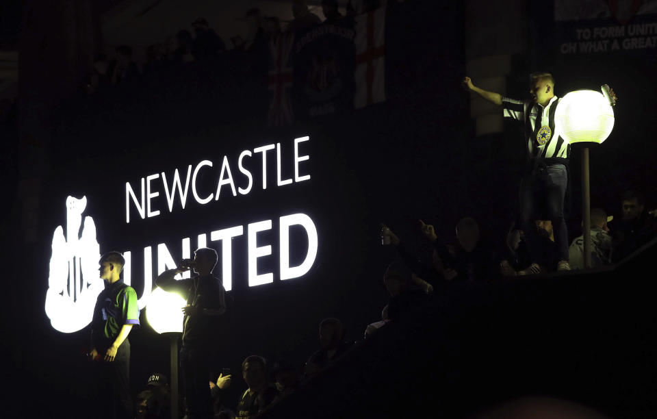 Newcastle United supporters celebrate outside St. James' Park in Newcastle Upon Tyne, England, Thursday Oct. 7, 2021. English Premier League club Newcastle has been sold to Saudi Arabia's sovereign wealth fund after a protracted takeover and legal fight involving concerns about piracy and rights abuses in the kingdom. (AP Photo/Scott Heppell)