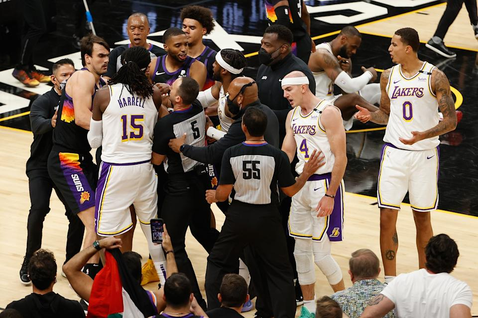 The Lakers' Montrezl Harrell, Alex Caruso and Wesley Matthews come together with the Suns' Dario Saric, Cameron Payne and Mikal Bridges in an altercation during the second half of Game 1 of their Western Conference first-round playoff series at Phoenix Suns Arena on May 23, 2021. ( Christian Petersen/Getty Images)